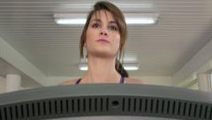 Sports and young people in gym, beautiful girl training, running Stock Footage