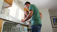 Mexican couple doing the dishes together Stock Footage