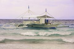 Tukijalkojen veneen myrskyinen meri, Filippiinit Kuvituskuvat