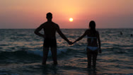 Couple silhouette at the beach. Sunset light. Stock Footage