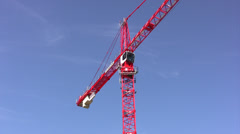 Bright red tower crane angled shot Stock Footage