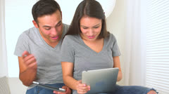 Stock Video Footage of Happy Mexican couple using their tablets