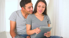 Happy Hispanic couple using their tablets - stock footage