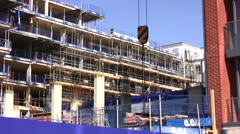 Crane hook with scaffolding in background Stock Footage