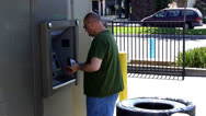 Stock Video Footage of Man At ATM Machine Takes Money And Walks Away