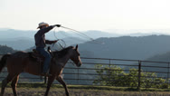 Cowboy rides horse with lasso Stock Footage