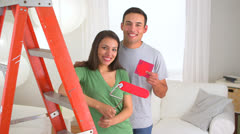 Excited Mexican couple renovating house - stock footage