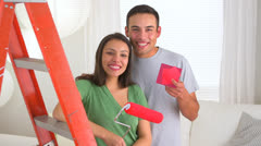 Stock Video Footage of Happy Mexican couple renovating house