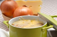onion soup with melted cheese and bread on top - stock photo