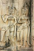 Wall bas-relief of devatas, angkor wat temple, siem reap, cambodia Stock Photos
