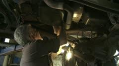 Mechanic Under Car - stock footage