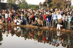 Tourists photographing sunrise at angkor wat, siem reap, cambodia Stock Photos