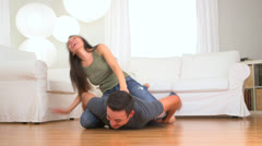 Mexican couple playing on the floor Stock Footage