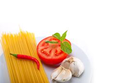 Italian spaghetti pasta tomato ingredients Stock Photos