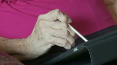 Using Computer Tablet with Arthritis - stock footage