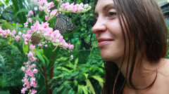 Beautiful girl with butterflies Stock Footage