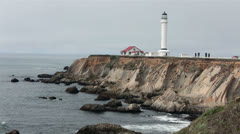Historic Point Arena lighthouse calm ocean waves HD 6207 Stock Footage