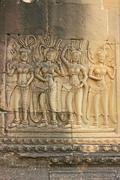 Wall bas-relief of devatas, angkor wat temple, siem reap, cambodia Stock Photos