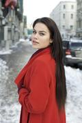 Stock Photo of portrait of a young woman on the background of a winter city