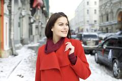 Portrait of a young woman on the background of a winter city Stock Photos