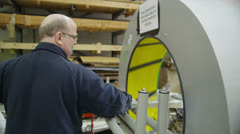 Operator using a packaging machine to prepare goods for delivery Stock Footage
