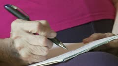 Stock Video Footage of Writing with Arthritis - Front View