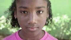 Portrait of happy young african girl looking at camera, smiling Stock Footage