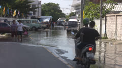 A Motorcycle in a Flooded Road p159 Stock Footage