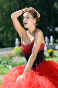 Beautiful young women in red dress Stock Photos