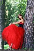 Young woman in a red gothic dress Stock Photos