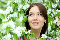 portrait of beautiful woman in spring blossom - stock photo