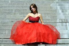 Beautiful young women in red dress Stock Photos