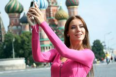 young woman photographed attractions in moscow - stock photo