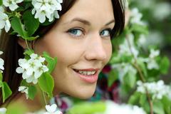 Stock Photo of portrait of beautiful woman in spring blossom