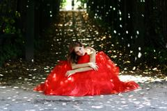 Stock Photo of young woman in a red gothic dress