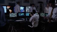 Security team watching the screens in a dark system control room Stock Footage