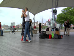 Dancers in New York City Pier Dance on a Sunny Afternoon for Joy and Recreation Stock Footage