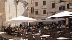 Croatia, Dubrovnik, Civilians Seated at Outdoor Restaurant Stock Footage