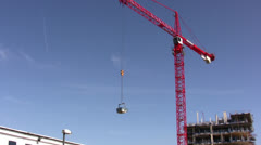 Timelapse of crane turning arm with load attached - stock footage