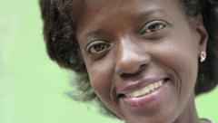 Portrait of happy mature black woman looking at camera - stock footage