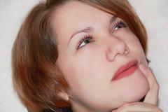 Portrait of girl with glance upwards Stock Photos
