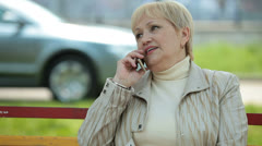 Active Senior Lady On The Phone Outdoors Stock Footage