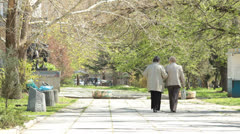 Senior women walking along the alley Stock Footage