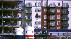 Construction workers on a platform with crane hook and cable Stock Footage