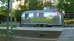 RV Cookie Trailer In Park Stock Footage