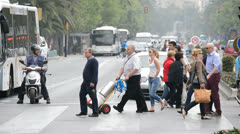 People walking zebra crossing Stock Footage