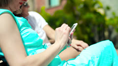 Woman hands texting message on smartphone in the park, steadicam shot - stock footage