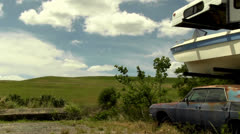 Pan shot of abandoned and rusty cars Stock Footage