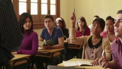 Professor speaking to group of students in school classroom Stock Footage