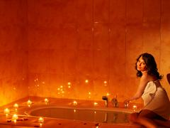 woman relaxing in sauna. - stock photo